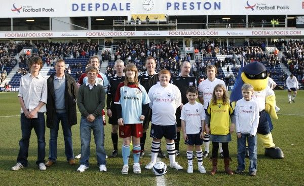 Football - Preston North End v Burnley - Coca-Cola Football League Championship - Deepdale - 08/09 - 17/1/09 Preston North End's Paul McKenna and Burnley's Stephen Caldwell with match officials and mascots before the match Mandatory Credit