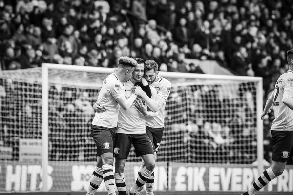 Three of the four goalscorers celebrate together with an embrace as PNE beat local rivals Blackburn Rovers 4-1 at Deepdale. PNE v Blackburn Rovers, Home Kit, Callum Robinson, Alan Browne and Tom Barkhuizen Goal Celebration