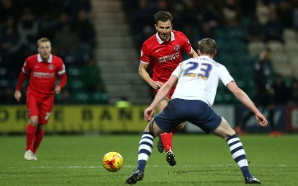 Charlton Athletic's Marco Motta battles for the ball with Preston North End's Greg Cunningham (foreground)