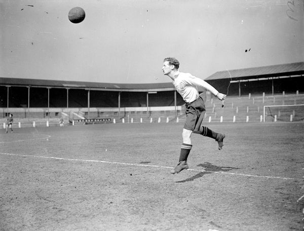 A black and white photo of Sir Tom Finney heading the ball at Deepdale in training. Tom Finney, Preston North End