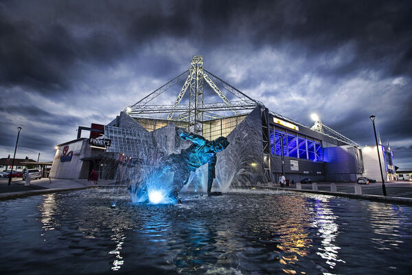Sir Tom Finney's 'The Splash' fountain lights up blue at Deepdale