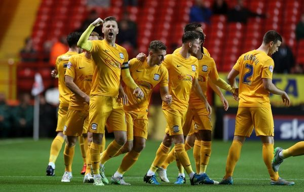 Preston North End's Paul Gallagher celebrates scoring his side's first goal of the game with teammates
