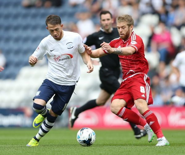 Preston North End's Joe Garner (left) and Middlesbrough's Adam Clayton battle for the ball
